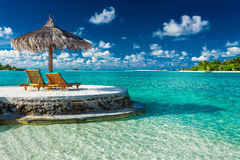 Two beach chairs under umbrella with ocean view in Maldives Royalty Free Stock Image