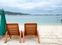 Two beach chairs on white sand. At phi phi island Royalty Free Stock Images