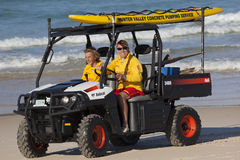 Two beach lifesavers in a surf patrol cart. Fingal Bay. Port Ste. Phens. Australia Royalty Free Stock Photography