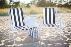 Two beach lounges with beach bag and white hat Royalty Free Stock Photo