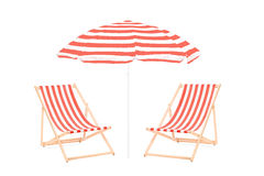Two beach sun loungers and an umbrella. Isolated on white background stock photography