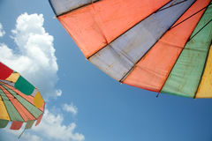 Two beach umbrellas Stock Images