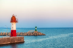 Two beacons stand on pier Royalty Free Stock Photos