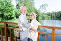 Two beaming pensioners smiling broadly feeling excited for picnic. Excited for picnic. Two beaming pensioners smiling broadly while feeling excited for amazing royalty free stock photography