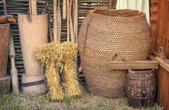 Two beams and ancient objects of rural life. Royalty Free Stock Images