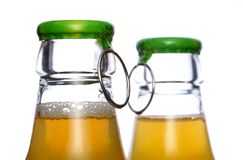 Two bear bottles. Pair bear or juce bottles lid with open ring Stock Image
