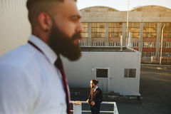 Two bearded businessman looking at something Royalty Free Stock Images