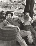Two bearded men lounging Stock Images