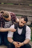 Two bearded men shave. Two bearded man shave outdors shave brutall Stock Image