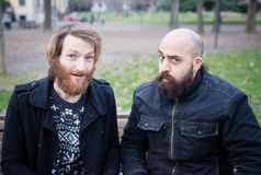 Two bearded modern man working on tablet Stock Photos