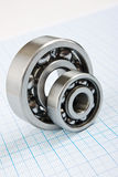 Two bearings. On graph paper stock photo