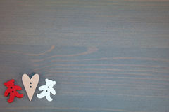Two bears with hearts on grey wooden background. Royalty Free Stock Images