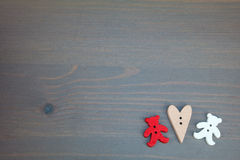 Two bears with hearts on grey wooden background. Button bears love. Button love. Wooden buttons. Post card for the Valentine Stock Photography