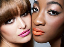 Two beauties with perfect skin. Two beautiful women with perfect skin close together Stock Images