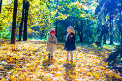 Two beautiful adorable girls walking in the fall Royalty Free Stock Photos