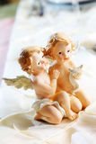 Angels. Two beautiful angels holding a bird Royalty Free Stock Photo