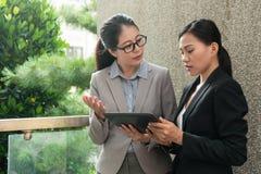 Beautiful Asian business woman discuss royalty free stock photos
