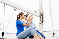 Two beautiful, attractive young girls taking pictures on a yacht Royalty Free Stock Images