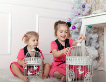 Two beautiful baby at   Christmas tree. Royalty Free Stock Image
