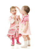 Two beautiful baby in the pink dress royalty free stock photography