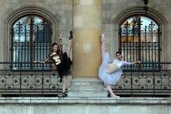 Two beautiful ballerinas dancing outdoor Stock Images