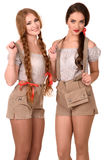 Two beautiful blond and brunette girls of oktoberfest royalty free stock image