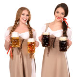 Two beautiful blond and brunette girls of oktoberfest beer stein Stock Photography
