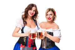 Two beautiful blond and brunette girls of oktoberfest beer stein Stock Images