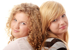 Two beautiful blond teen girlfriends Stock Photos