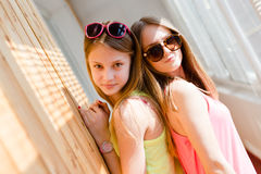 Two beautiful blond teenage girls having fun happy smiling Stock Photo