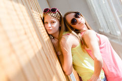 Two beautiful blond teenage girls having fun happy smiling Royalty Free Stock Photos