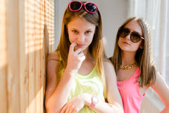 Two beautiful blond teenage girls having fun happy smiling Royalty Free Stock Images