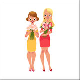 Two beautiful blond women, girls standing, holding bunches of flowers Royalty Free Stock Images