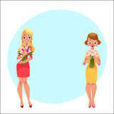 Two beautiful blond women, girls standing, holding bunches of flowers Stock Photo