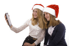 Two beautiful blonde in santa claus hat with tablet pc Royalty Free Stock Photos
