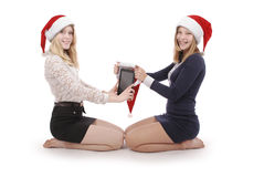 Two beautiful blonde in santa claus hat with tablet pc Royalty Free Stock Photo