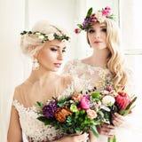 Two Beautiful Blonde Women Fiancee. Fashion Model with Flowers Stock Image