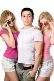 Two beautiful blonde women with handsome young man Stock Photography