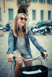 Two beautiful blonde women shopping on bike Stock Photos