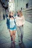 Two beautiful blonde women walking and talking Royalty Free Stock Images