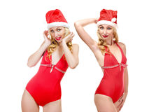 Two beautiful blondes in bathing suits and a cap o Royalty Free Stock Image