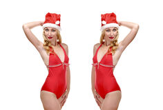 Two beautiful blondes in bathing suits and a cap o Royalty Free Stock Photo
