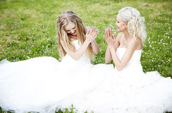 Two beautiful bride in the garden Stock Photos
