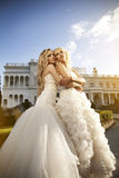 Two beautiful bride in the garden Stock Photo