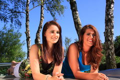 Two beautiful brunette girls relaxing Royalty Free Stock Photo
