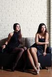 Two beautiful brunette sitting in cafe Royalty Free Stock Photography