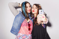 Two beautiful brunette women (girls) teenagers spend time togeth Royalty Free Stock Images