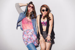 Two beautiful brunette women (girls) teenagers spend time togeth Royalty Free Stock Photography