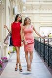 Two beautiful brunette women in sexy dress Stock Photo