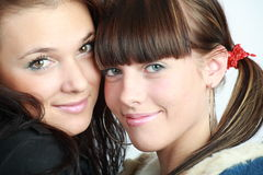 Two beautiful brunettes. Portrait of two beautiful brunettes smiling royalty free stock images